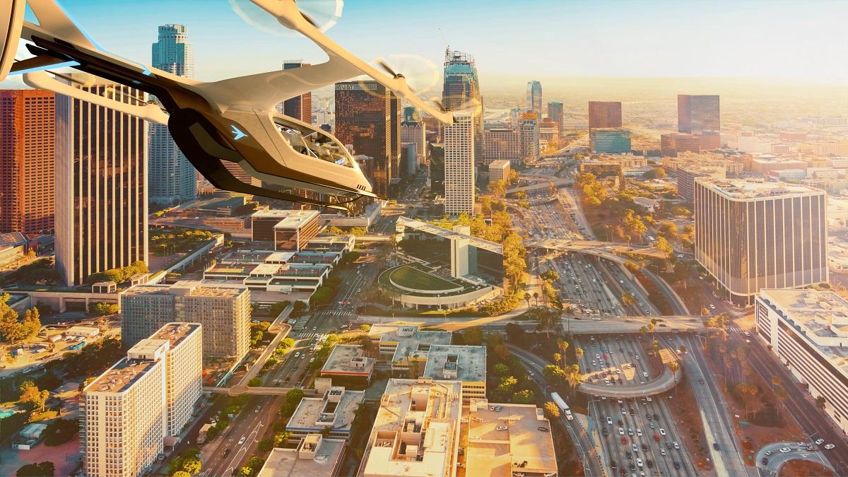 EmbraerX eVTOL flying over city