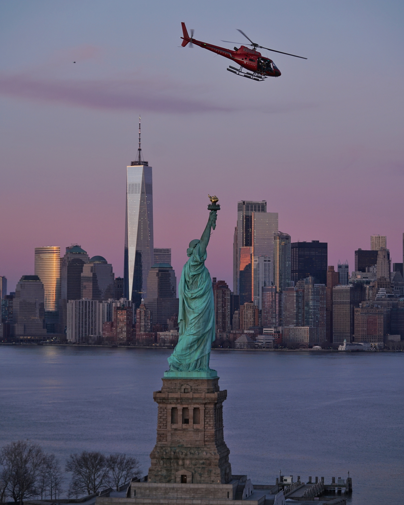 FlyNYON helicopter with Statue of Liberty